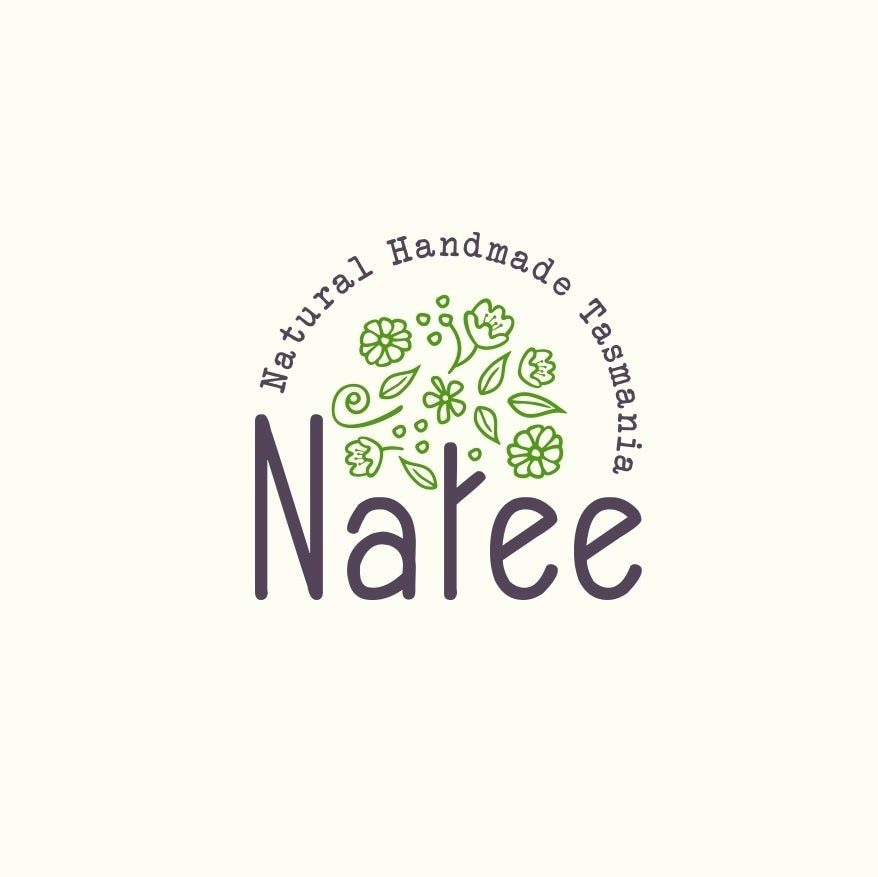 """round logo with the letter """"t"""" in """"Natee"""" illustrated as a tree trunk with green leaves and flowers floating above it"""