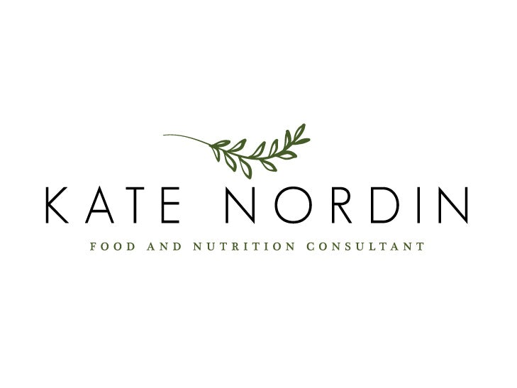 """Simple  logo  of the name """"Kate Nordin"""" beneath a vine with multiple leaves"""