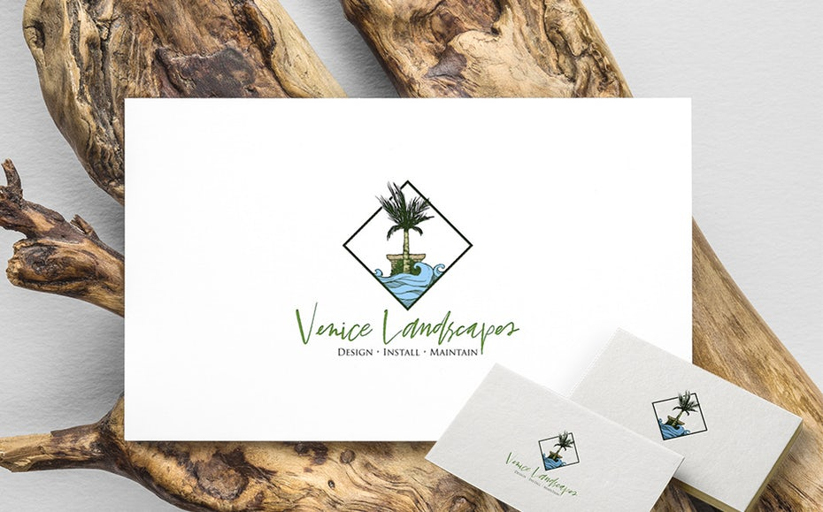 """diamond-shaped  logo  showing a palm tree and water with the text """"Venice Landscapes"""""""