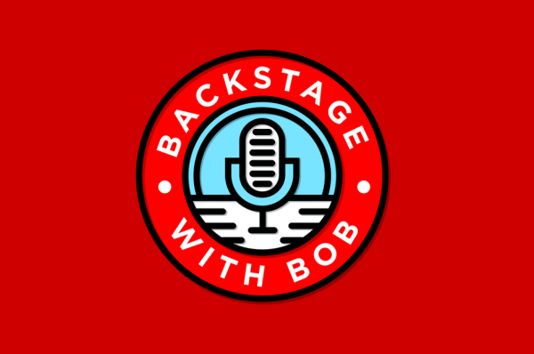 """Round logo featuring a microphone with the text """"Backstage with Bob"""""""