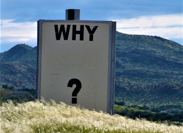 sign in the field saying 'why?'